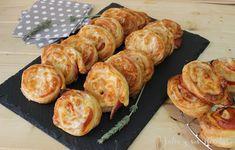 Unos entrantes enrollados muy ricos, de hojaldre , jamón cocido y queso, no te los pierdas, puedes verlos en mi blog Julia y sus recetas