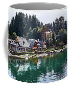 Coffee mug featuring the Municipal Museum of Villa La Angostura (Spanish for Narrowness-ville) showing its reflection on the water and surrounded by pine trees on a snowy day in Río Negro, Argentina. Our ceramic coffee mugs are available in two sizes: 11 oz. and 15 oz. Each mug is dishwasher and microwave safe. Worldwide shipping within 1 - 2 business days. Click through to get yours! Art for your life by Eduardo Jose Accorinti.