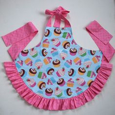 My 4yo has been not so patiently waiting for her new apron. Previously, she used a hand me down one from her sister, but it was getting pretty small. She wanted to match my cupcake apron, but I let her choose the fabric for the back, ruffle, and ties. She LOVES to bake with me. Especially cookies or anything with sprinkles. And now we can match. I took pictures as I was making this apron,…