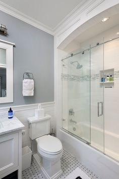 Like the arch & lighting in this shower/tub combo Guest bath and basement bath shower framing Vanity looks like a piece of furniture