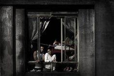 In a Window of Prestes Maia 911 Building by Julio Bittencourt