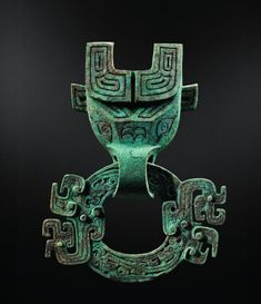 Bronze Taotie mask and ring, China, Spring and Autumn period, 770-481 BC