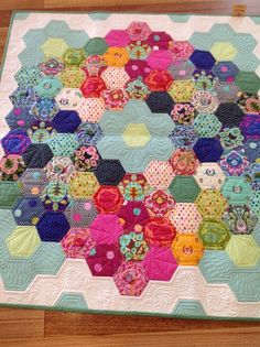 """Tula Pink's newest range Slow & Steady includes PRE CUT Hexagons. Oh man, am I happy about that. This bundle includes 42 4.75"""" hexagon..."""