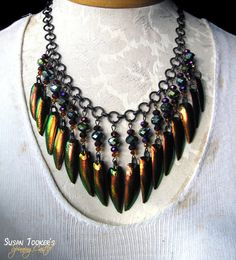 Copper iridescent Jewel Beetle Elytra are the focus of TITANIA'S TRINKETS amulet necklace. Made by Susan Tooker of Spinning Castle.