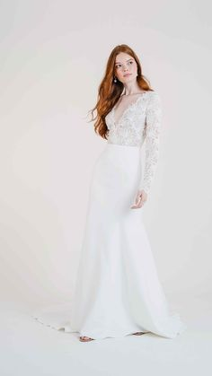 Meet Jenny Yoos Veda gown for Fall 2020. Get lost in the lace of this decadent long sleeve gown while her supple Matte Crepe skirt seals the deal. Featuring a V neckline, Lace and Matte Crepe, a fit and flare silhouette, semi sheer bodice, and a long chapel train skirt. This gorgeous, romantic and boho wedding dress is a Fall / Winter wedding winner.