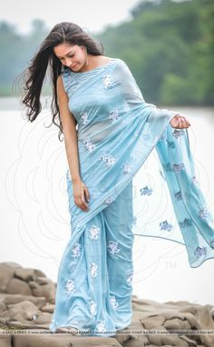 Featuring a soft powder blue pure silk chiffon saree with light white ribbonwork floral motifs embroidered all over it. Please visit this link to purchase the saree. Please visit this link to purchase the saree. Saree Draping Styles, Saree Styles, Chiffon Saree, Silk Chiffon, Organza Saree, Floral Chiffon, Indian Dresses, Indian Outfits, Collection Eid