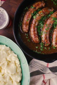 Bangers and Mash with Beer and Onion Gravy. I would have to make this with chicken or turkey sausage, though, since I am allergic to pork.