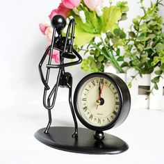 Creative fashion design metal products iron man playing trombone clock Desktop Home Decoration birthday gift, View metal products clock, desktop clock Product Details from Dongguan Dream Gift Factory on Alibaba.com