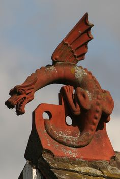 A red tile dragon sits on the roof of the Rye House pub beside the Lee and Stort Navigation in Hertfordshire.