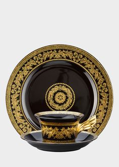 Gold Baroque Set by Versace Home. Set of plate, cup and saucer in porcelain. Featuring the elegant Baroque print in which golden details stand out on a black background. An iconic Versace pattern on elegant tableware for the home. Versace Gold, Tea Cup Set, Tea Cup Saucer, Tea Sets, Versace Pattern, Baroque Decor, Fine Porcelain, Teller, Ceramic Plates