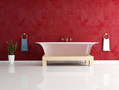 """Design tip: Highlight your tub by painting your walls """"Netflix red."""" 