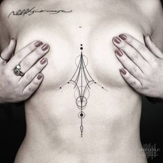 "Geometric sternum piece, and collarbone tattoo saying ""Nihil fit sine causa."" Tattoo artist: Okan Uçkun"
