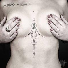 "Geometric sternum piece, and collarbone tattoo saying ""Nihil fit sine causa."" By Okan Uçkun."