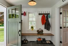 Fetching design mud room ideas come with gray floor tiles and brown wooden floating mud room bench plus wall mounted clothes hooks. Interesting design for mud room ideas. Mudroom, House Entrance, Mudroom Design, New Homes, House Interior, Entrance Decor, Farmhouse Entry, Enclosed Front Porches, Mud Room Entry