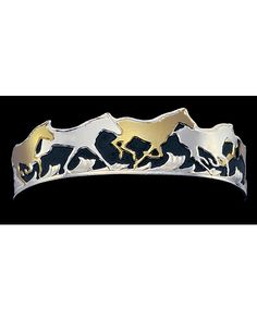 <p>This cuff style bracelet features gold and silver running horses. Our Skilled Craftsmen are the finest in the western industry. These products are a combination of traditional western designs, a unique modern flair, and crisply executed engraving styles unmatched in their brilliance. Silver electroplated and protected with Montana Armor , a technological breakthrough developed by Montana Silversmiths in 1988.This durable finish gives all of our products superior protection. No other ...