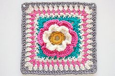 Ravelry: Multi-colour flower blanket square - free  pattern by Fiona Kelly here: http://www.tangledblossomsdesign.com/2008/11/1st-of-free-blanket-square-patterns.html?m=1