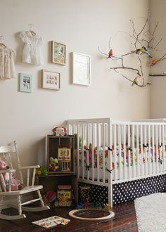 Like the branches and dresses hanging from the wall.  Would be a good way to display their baptismal gown.