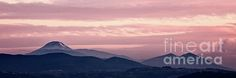 Magenta sunset in the mountain landscape with cloudy sky
