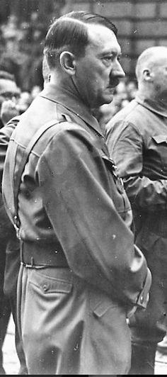 November 9, 1938, Hitler doing yet another reenactment of the Putsch. (via putschgirl)