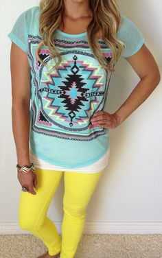 Tribal Cove Top looks perfect with a pair of bright skinny jeans! It's new and we love this top!! Pick blue or black at http://www.sexymodest.com/collections/featured/products/tribal-cove-top #sexymodestboutique #newarrivals
