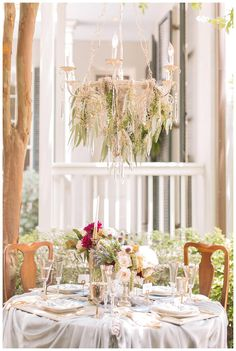 Beautiful outdoor wedding reception tabletop with hanging chandelier with greenery. Florals by Bee's Weddings and Events with event design collaboration by Blue Gardenia Events. Image by Arte De Vie. Flower Chandelier, Hanging Chandelier, Outdoor Wedding Reception, New Orleans Wedding, Southern Weddings, Floral Centerpieces, Arches, Destination Wedding Photographer, Fresco