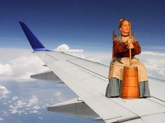 there is a colonial woman on the wing! i repeat a colonial woman on the wing of the plane! There's something they're not telling us!
