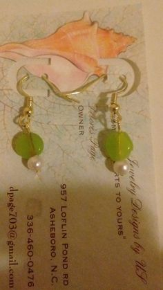 Check out this item in my Etsy shop https://www.etsy.com/listing/280601178/gold-tone-earrings-with-green-beads-and