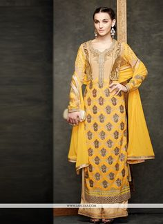 Include yourself with the glamour of the season with this yellow georgette and net designer suit. This wonderful attire is showing some fantastic embroidery done with embroidered and resham work. Come...