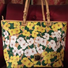 Authentic Dooney& Bourke floral print shoulder bag Authentic Dooney and Bourke large leather shoulder bag with floral print, gold logo medallion and leather shoulder straps. This bag is brand-new with tags's and registration card. Dooney & Bourke Bags Shoulder Bags