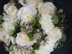 white bridal bouquet roses, carnations, wax flower