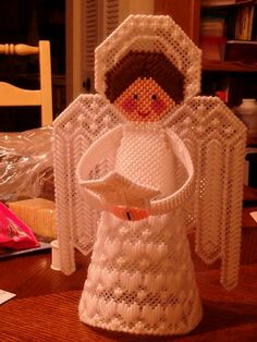 Plastic Canvas angel.  This angel has been adorning the top of our tree for many years.  DOES NOT HAVE LINK TO PATTERN
