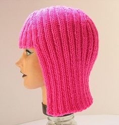 Knitted Wig - Megan Reardon -  The designer, Megan Reardon, knitted it in fluorescent pink wool for Halloween. It's called the 'Hallowig'. I think the pink wool gives it a very futuristic dimension and also a bit like the girl's hair in the children's TV show Lazy Town. If you knitted it in a more naturalistic hair colour it would be the perfect 'Hat' for those bad hair days. The pattern for this wig can be found at Knitty : http://knitty.com/ISSUEfall04/PATThallowig.html