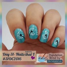 """Day 31 - inspired by nails I love  #31dc2016 --------------------- - - - -  I chose this dandelion wind  done by @nails_by_yoko .  I didn't come anywhere near to how well she did it - but I reckon """"A"""" for effort.  And just like that ladies and gents.. IT IS A WRAP !!!! The challenge is now over. --------------------------- - - - - -  Used #chinaglaze -  what I like about blue,  #LAGIRL - blackout,  #essence -  wild white ways. . 💅💅💅💅💅💅💅💅 All artwork was done freehand…"""