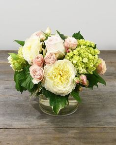 c1cbe1fa75c1 A lovely collection of premium pastel garden and spray roses accented with  green hydrangea designed in