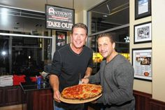 Former Miami Dolphins quarterback Dan Marino (and partner in the pizza franchise) with store owner Anthony Bruno at the grand opening of Ant...