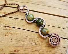 Fancy Jasper Greens wire wrapped in antiqued copper with a swirl