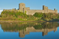 Pembroke Castle    Situated on the banks of the River Estuary, Pembroke Castle has tunnels, passageways, and stairways that one can explore. Tudor buffs will also love the fact that Henry Tudor was born here. Another plus: the castle is mostly intact.