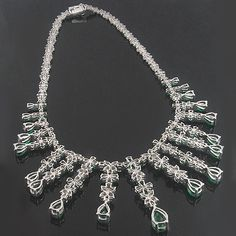 This dazzling 18K Gold Diamond & Emerald Necklace weighs approximately 90 grams and showcases 13.31 ctw of sparkling round and marquise cut diamonds, and 28.52 ctw of gorgeous pear shaped emeralds, each masterfully prong set in a lustrous 18K gold frame. Featuring a magnificently endless flower design and a highly polished gold finish, this one of a kind diamond and emerald necklace from our celebrity jewelry collection is a true collector's item.