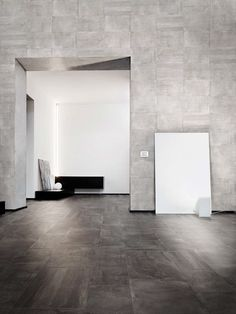 Studio Marmi Concrete Charcoal Weathered 18x36 and 12x24 Floor and Grey Linear 18x36 Rigato Wall.