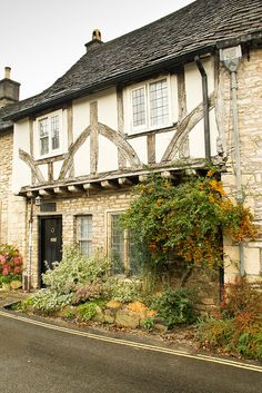 The Old Court House in Castle Combe, Wiltshire | Flickr - Photo Sharing. a nice foundation plants arrangement idea.
