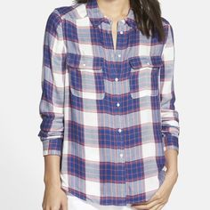 Paige Trudy Plaid Flannel Shirt A plaid print and a rounded high/low hem update the look of this classic button-front shirt and is perfect for layering under vests or with jeans.  Front button closure. Spread collar. Chest button-flap pockets. 100% viscose. Dry clean. By Paige Denim; imported. Paige Jeans Tops Button Down Shirts