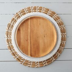 """Carved from natural acacia, this rustic plate is polished to showcase the wood's intricate grain.- Acacia wood- Hand wash- Apply mineral oil regularly- ImportedSmall: 9.75"""" diameterLarge: 11.75"""" diameter"""
