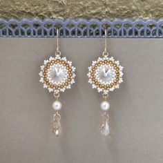 I created this earrings by hand, using golden shadow Swarovski (12mm) revoli for each one, Swarovski 5mm pearls, Miyuki round seed beads, Miyuki Delica beads and goldfilled 14k earrings. * Measurements: Earring length: 2.36 (6cm) Pendant diameter: 0.78 (2cm) * The earrings will come beautifully packaged for gift. * For other Bridal earrings: https://www.etsy.com/shop/LioraBJewelry/items?section_id=16552834 * my shop: https://www.etsy.com/shop&#...