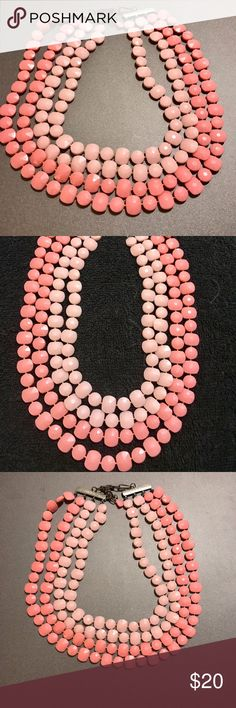 Gorgeous Vintage Coral Colored 3 Strand Necklace This vintage 3 strand multi-coral colored necklace is stunning as well as fun & funky.  If you're looking for a statement piece, you've found it!                                                                        Please contact me with any questions and I'll respond promptly.  Thank you for taking a look and check out my other listings! Vintage Jewelry Necklaces