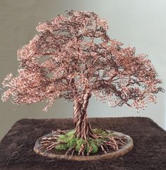 he word bonsai is most closely associated by most with the growing of miniature trees, and although this is somewhat accurate, there is a lot more to it than that. A bonsai is not a genetically overshadowed plant Wire Tree Sculpture, Sculptures, Bonsai Tree Types, Bonsai Trees, Art Fil, Wire Earrings, Wire Jewelry, Beaded Jewelry, Handmade Jewelry