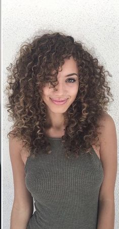 Long Curly Hairstyles and Colors 2019 long curly hairstyles; trendy hairstyles and colors side part long curly hair; middle parted long curly hairlong curly hairstyles; trendy hairstyles and colors side part long curly hair; middle parted long curly hair Curly Hair Fringe, Curly Hair Styles, Curly Hair With Bangs, Crimped Hair, Colored Curly Hair, Haircuts For Curly Hair, Curly Hair Cuts, Long Hair Cuts, Hairstyles With Bangs