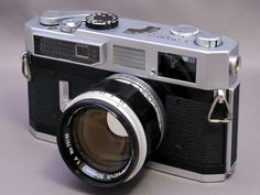 The Canon 7 1961 - was the first camera of the 3rd and last generation rangefinder system camera from Canon.  These were the last Canons compatible with the Leica M39 lens mount.  It was the first Canon with a built-in meter.