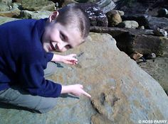 Boy Stumbles Across Dinosaur Footprints whilst Walking on Beach