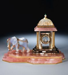 CARTIER 'THE GRAND MOGUL PAVILION MYSTERY CLOCK' http://www.jewelsdujour.com/wp-content/uploads/2013/03/CARTIER-THE-GRAND-MOGUL-PAVILION-MYSTERY-CLOCK.jpg