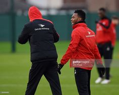 Jurgen Klopp manager of Liverpool Daniel Sturridge during a training session at Melwood Training Ground on December 5, 2015 in Liverpool, England.